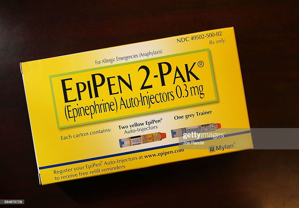 In this photo illustration EpiPen which dispenses epinephrine through an injection mechanism for people with severe allergies is seen as the company...