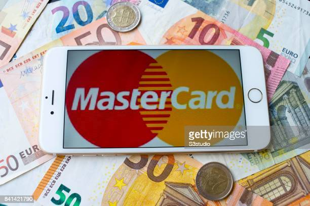 In this Photo Illustration Euro banknotes and coins with MasterCard sample on an iPhone 6s Plus are arranged for a photograph on 30 August 2017 in...
