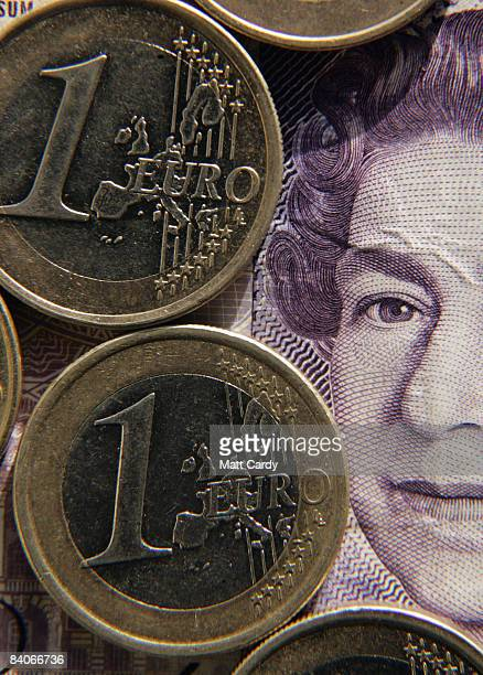 In this photo illustration Euro coins are seen by a British 20GBP note on December 17 2008 in Bristol England The British Pound is currently at its...