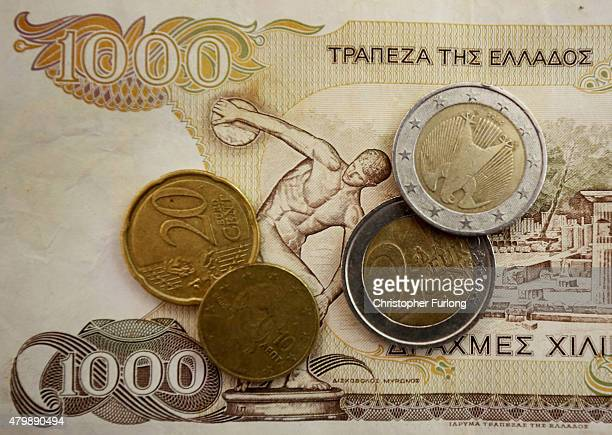 In this photo illustration Euro coins lay on a 1000 Drachma note the currency in Greece before the Euro on July 8 2015 in Athens Greece Eurozone...