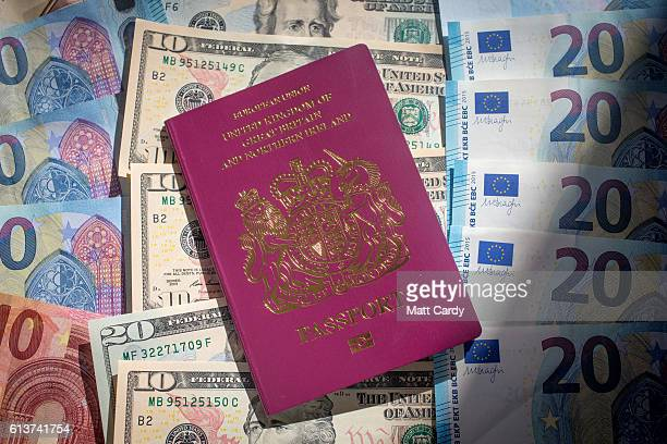 In this photo illustration Euro Dollar and pound sterling notes are seen beside a UK passport on October 10 2016 in Bath England Since the UK voted...