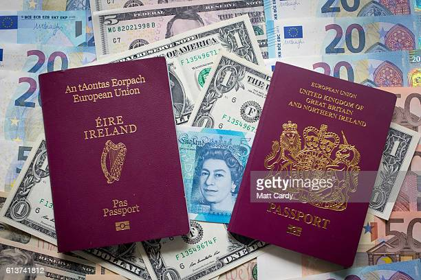 In this photo illustration Euro Dollar and pound sterling notes are seen beside a Irish and UK passports on October 10 2016 in Bath England Since the...