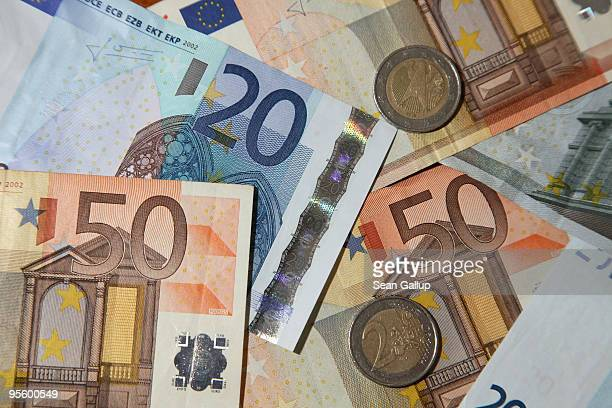 In this photo illustration Euro notes and coins lie on a table on January 6 2010 in Berlin Germany According to data compiled by Stern magazine from...