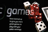 In this photo illustration gaming dice are displayed on a screen on an online gambling website on August 7 2006 in London Online gambling is one of...