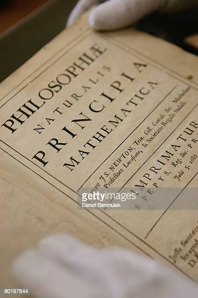 In this photo illustration Head of Library and Archives Rupert Williams holds a copy Philosphiae Naturalis Principia Mathematica by Sir Isaac Newton...