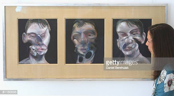 In this photo illustration Head of PostWar and Contemporary Art Christies London Pilar Ordovas observes a painting by Francis Bacon called Three...