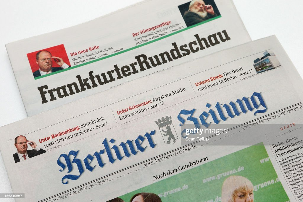 In this photo illustration issues of the Frankfurter Rundschau and Berliner Zeitung newspapers are seen on November 13, 2012 in Berlin, Germany. According to media reports Frankfurter Rundschau has filed for bankruptcy, and the future of its partner paper, Berliner Zeitung, is uncertain.