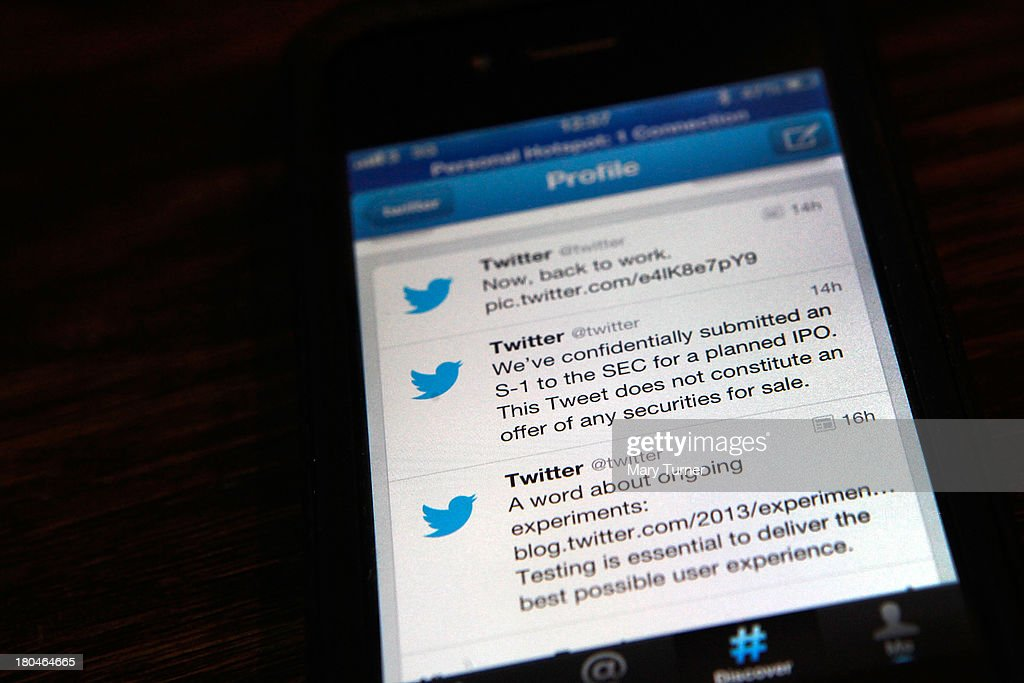 In this photo illustration, logos for the microblogging site Twitter, displayed on the internet on a mobile telephone on September 13, 2013 in London, England. Twitter has announced plans to float on the stockmarket.