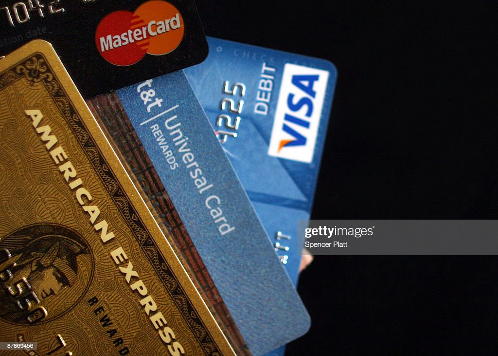 In this photo illustration, major U.S. credit cards are seen on May 20, 2009 in New York City. In new landmark credit card legislation, the United States Senate has voted 90 to 5 to pass a bill that would restrict credit card issuers' ability to further raise interest rates and charge fees. Known as the Credit Card Accountability, Responsibility and Disclosure Act, or Credit CARD Act, the new rules would force companies to post their credit rules on the internet and provide cardholders with a written statement explaining pending interest-rate hikes 45 days in advance.