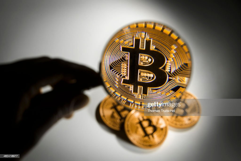 In this photo illustration model Bitcoins are seen trough a magnifying glass on January 13, 2014 in Berlin, Germany.