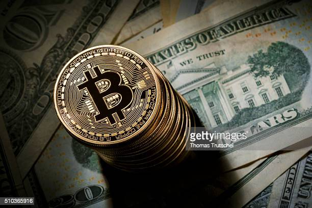 In this photo illustration model Bitcoins lying on Dollar bills on February 15 2016 in Berlin Germany