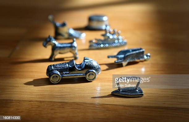 In this photo illustration Monopoly board game pieces are displayed on February 6 2013 in Fairfax California Toy maker Hasbro Inc announced today...