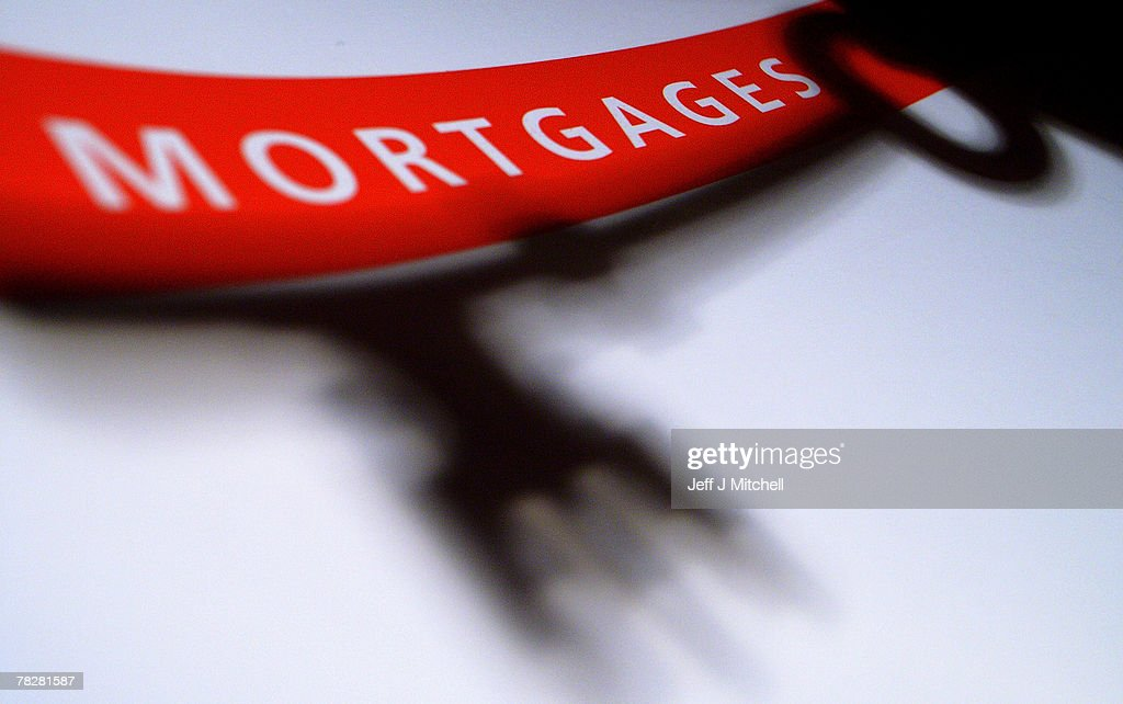 In this photo illustration of a mortgage application form the shadow of a house key held by a woman falls over the form on December 6 2007 in Glasgow...
