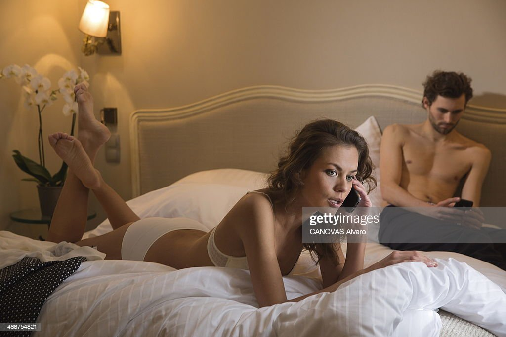 In this photo illustration of adultery, a couple lie on the bed of a hotel room on January 24, 2014 in France.
