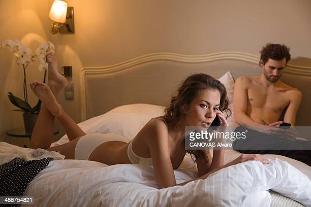 In this photo illustration of adultery a couple lie on the bed of a hotel room on January 24 2014 in France