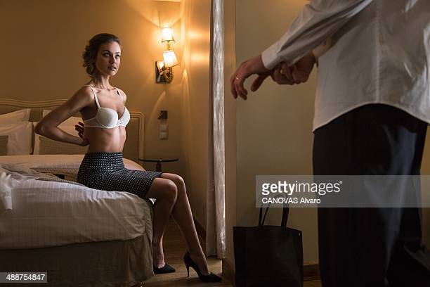 In this photo illustration of adultery a couple on the bed of a hotel room on January 24 2014 in France