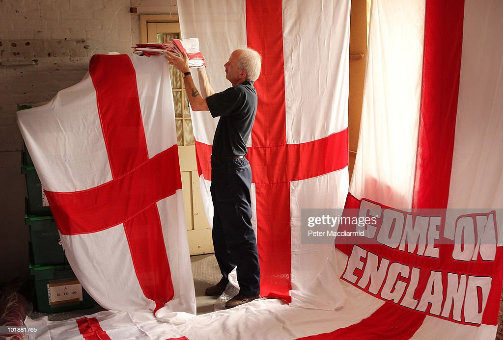 In this photo illustration Piggotts' employee Bob McWilliam checks stock of the Flag of St George in the warehouse of the flag maker on June 8 2010...