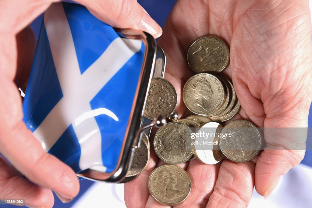 In this photo illustration pound coins are shaken from a purse on August 20 2014 in GlasgowScotland First Minister Alex Salmons chief economic...