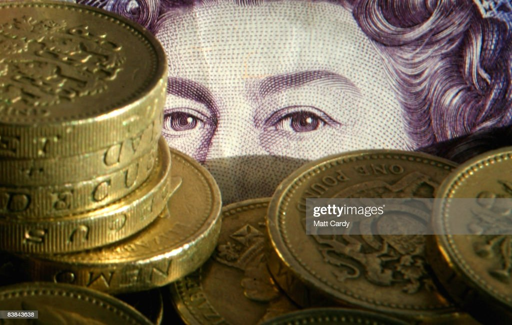 In this photo illustration pound coins are stacked in front of a twenty pound note on November 27 2008 in Bristol, England. Many UK consumers are feeling the pinch as the financial crisis and economic downturn makes borrowing harder and more expensive and the recession starts to bite.