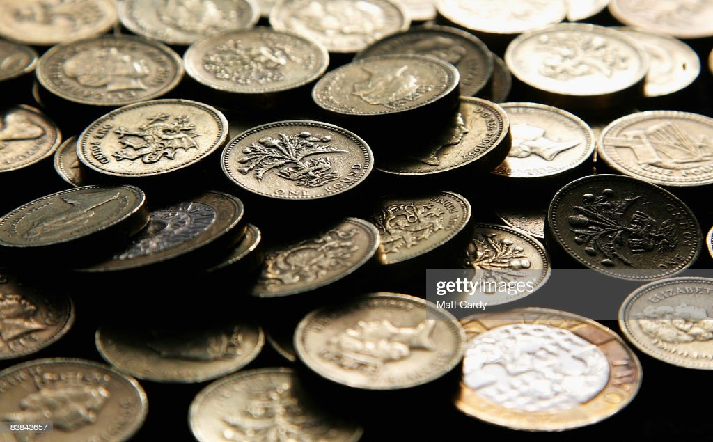 In this photo illustration pound coins are stacked up on November 27 2008 in Bristol, England. Many UK consumers are feeling the pinch as the financial crisis and economic downturn makes borrowing harder and more expensive and the effects of the recession begin to be felt.