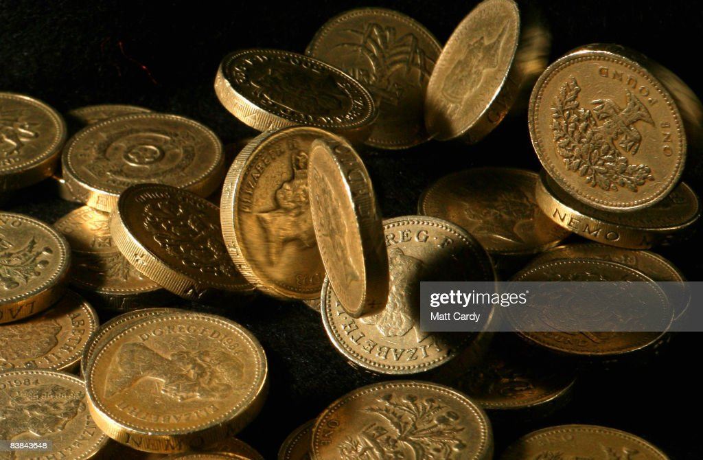 In this photo illustration pound coins drop in a pile on November 27 2008 in Bristol, England. Many UK consumers are feeling the pinch as the financial crisis and economic downturn makes borrowing harder and more expensive and the recession starts to bite.