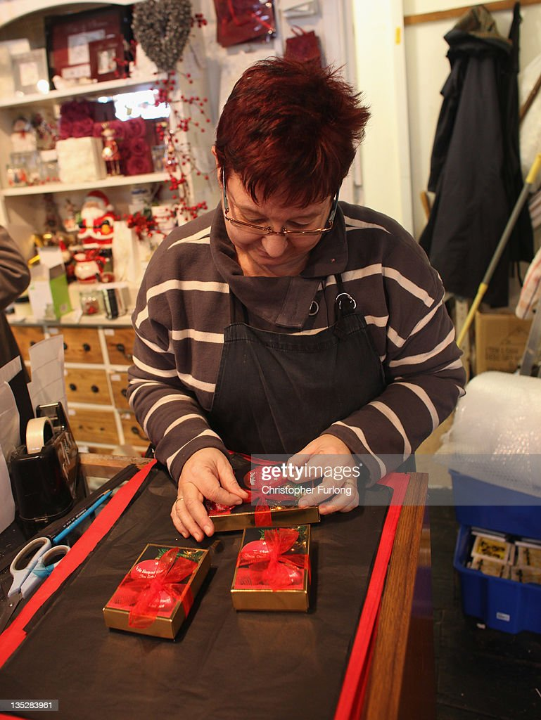 In this photo illustration sales assistant Sandra Stewardson wraps gift boxes of chocolates in her shop giftsandchocolates.com in the rural town of Ludlow in Shropshire on December 8, 2011 in Ludlow, England. With a weak outlook at the start of the Christmas shopping boom, many retailers are slashing prices with the hopes of combating poor sales.