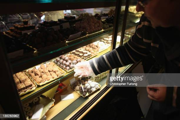 In this photo illustration sales assistant Sandra Stewardson wraps gift boxes of chocolates in her shop giftsandchocolatescom in the rural town of...