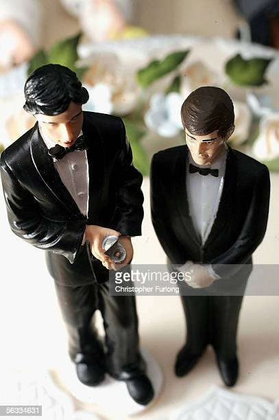 in this photo illustration same sex statues adorn the top of a wedding cake at a wedding specialists store on December 5 Birmingham England The Civil...
