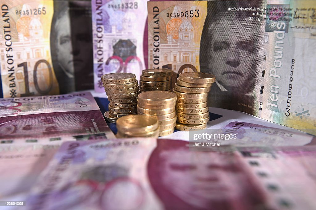 In this photo illustration Scottish Bank notes are placed on a table on August 20 2014 in GlasgowScotland First Minister Alex Salmons chief economic...