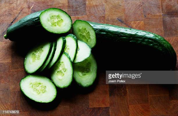 In this photo illustration sliced cucumbers lie on a table on May 26 2011 in Hamburg Germany German health authorities have announced they suspect...