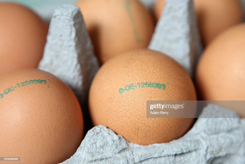 In this photo illustration, stamps indicating method of production, country of origin and production establishment, with 0 for organic, are seen on eggs sold as such on February 25, 2013 in Berlin, Germany. According to a report, hundreds of egg-providing companies in the country are inaccurately describing their products as organic ('bio' in German), a mislabeling due to the producers exceeding the permitted maximum number of chickens allowed to be kept in their cages at one time to be able to receive the official certification.