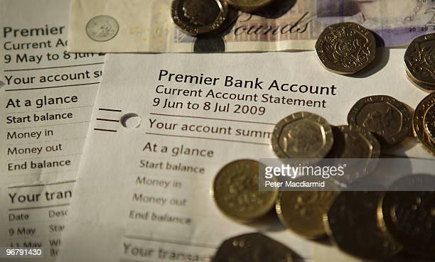 In this photo illustration Sterling notes and coins are displayed on a bank statement on February 17 2010 in London England As the UK gears up for...