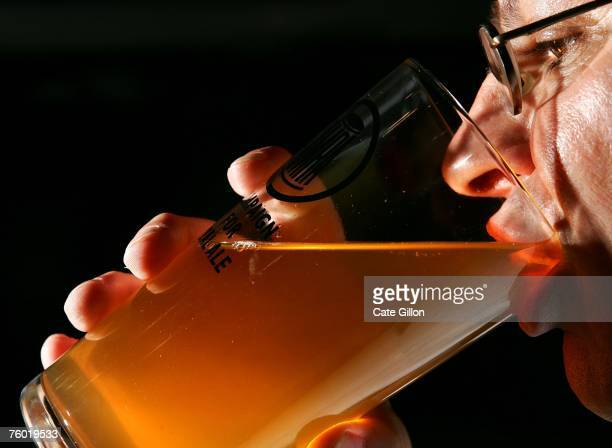 In this photo illustration Steve Williams the Regional Director for Greater London of CAMRA enjoys a pint of cider at the Beer Festival in Earls...
