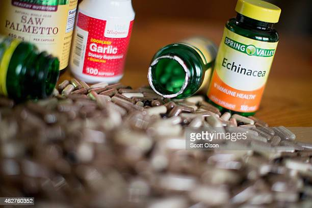 In this photo illustration supplements purchased at WalMart and Walgreens stores are shown on February 4 2015 in Chicago Illinois An investigation by...