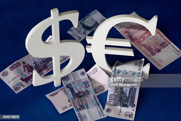 In this photo illustration the Dollar and Euro logo with Rubles banknotes is shown to illustate the world economy and finance on April 01 2014 in...