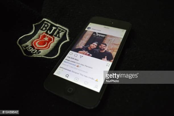 In this photo illustration the emblem of Besiktas football club and football player Diego Costa's latest post on Instagram are seen together in...
