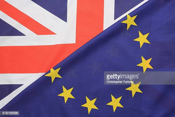 In this photo illustration the European Union and the Union flag sit together on March 17 2016 in Knutsford United Kingdom The United Kingdom will...