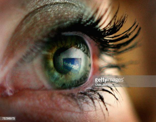 In this photo illustration the Facebook logo is reflected in an eye on July 10 2007 in London England Facebook has been rapidly catching up on...