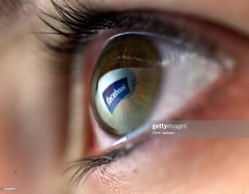 In this photo illustration the facebook logo is reflected in the eye of a girl on February 3 2008 in London England Financial experts continue to...