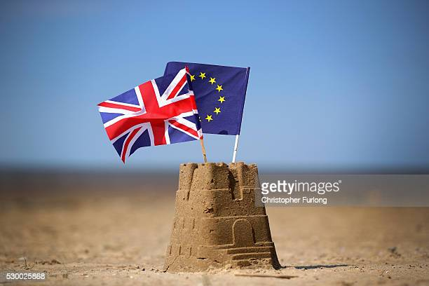 In this photo illustration the flag of the European Union and the Union flag sit on top of a sand castle on a beach on May 09 2016 in Southport...