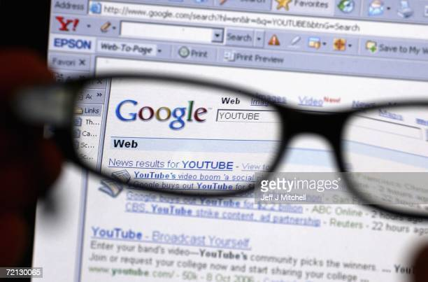 In this photo illustration the Google logo and YouTube Search text shows through a pair of glasses on October 10 2006 Google has bought YouTube the...