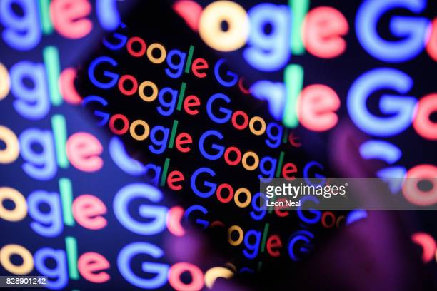 In this photo illustration The Google logo is displayed on a mobile phone and computer monitor on August 09 2017 in London England Founded in 1995 by...