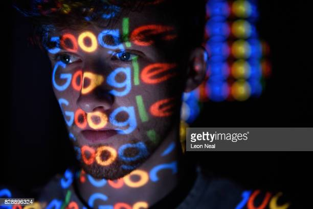 In this photo illustration The Google logo is projected onto a man on August 09 2017 in London England Founded in 1995 by Sergey Brin and Larry Page...