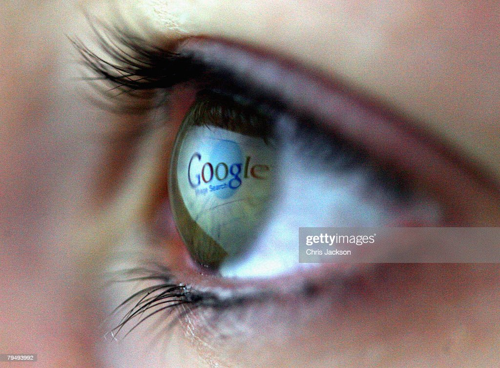 In this photo illustration the Google logo is reflected in the eye of a girl on February 3, 2008 in London, England. Financial experts continue to evaluate the recent Microsoft $44.6 billion (?22.4 billion) offer for Yahoo and the possible impact on Internet market currently dominated by Google.