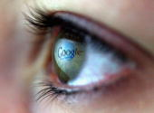 In this photo illustration the Google logo is reflected in the eye of a girl on February 3 2008 in London England Financial experts continue to...