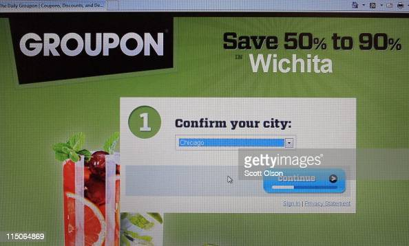 In this photo illustration the Groupon logo is displayed on the company's website June 2 2011 in Chicago Illinois Groupon announced today that it has...