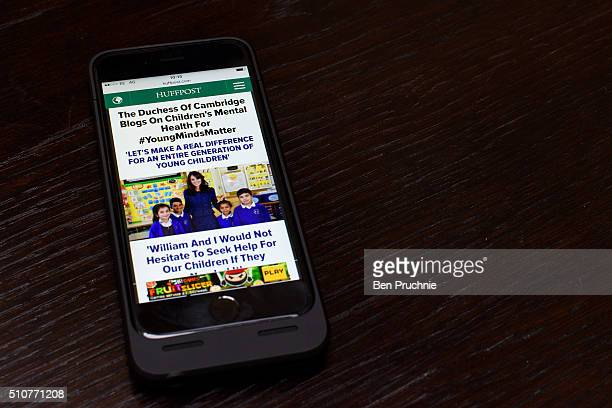 In this photo illustration the Huffington Post homepage is shown on an Apple Iphone 6 on February 17 2016 in London England Today The Duchess Of...