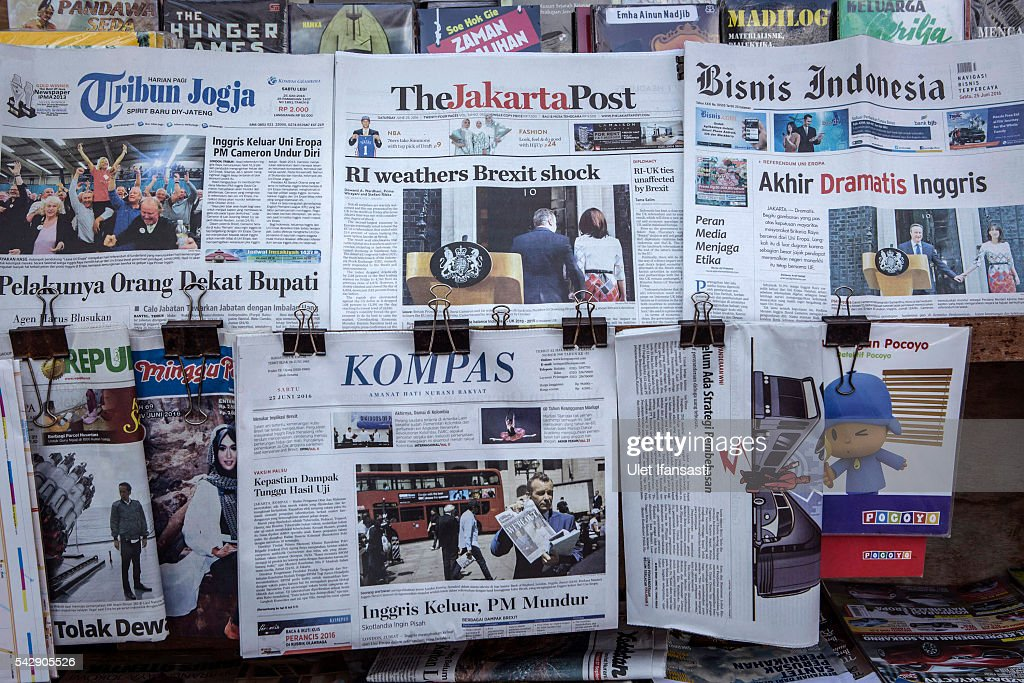 In this photo illustration, the Indonesian newspaper The Jakarta Post shows the cover headline which reads 'RI weathers Brexit shock', KOMPAS headline 'British exit, PM resign', Tribun Jogja headline 'British exit European Union, PM Cameron resign', Bisnis Indonesia reads 'Dramatic end of British' are displayed on a news stand on June 25, 2016 in Yogyakarta, Indonesia. The results from the historic EU referendum has now been declared and the United Kingdom has voted to LEAVE the European Union.