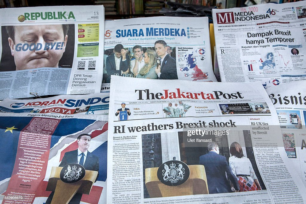 In this photo illustration, the Indonesian newspaper The Jakarta Post shows the cover headline which reads 'RI weathers Brexit shock', REPUBLIKA headline 'GOOD BYE', KORAN SINDO headline 'British looked at new era', SUARA MERDEKA reads 'Special status British are revoked', Media Indonesia reads 'Brexit impact was temporary' are displayed on a news stand on June 25, 2016 in Yogyakarta, Indonesia. The results from the historic EU referendum has now been declared and the United Kingdom has voted to LEAVE the European Union.