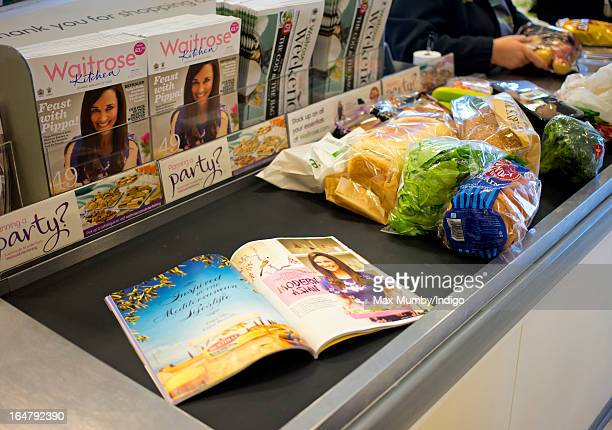 In this photo illustration the latest edition of Waitrose Kitchen Magazine featuring Pippa Middleton on the cover seen on a till conveyor belt in a...